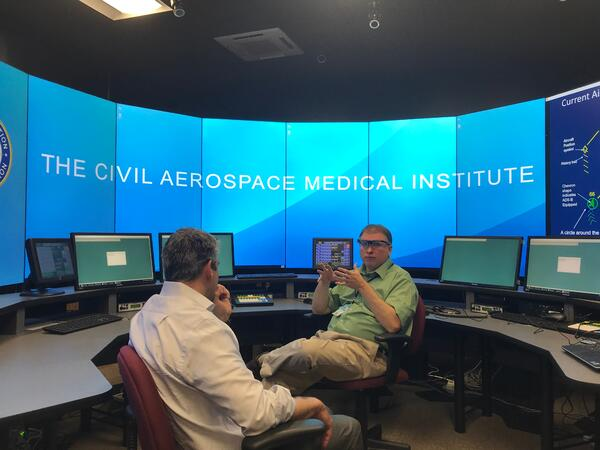 Exaptive CEO Dave King listens at an FAA lab in Oklahoma City