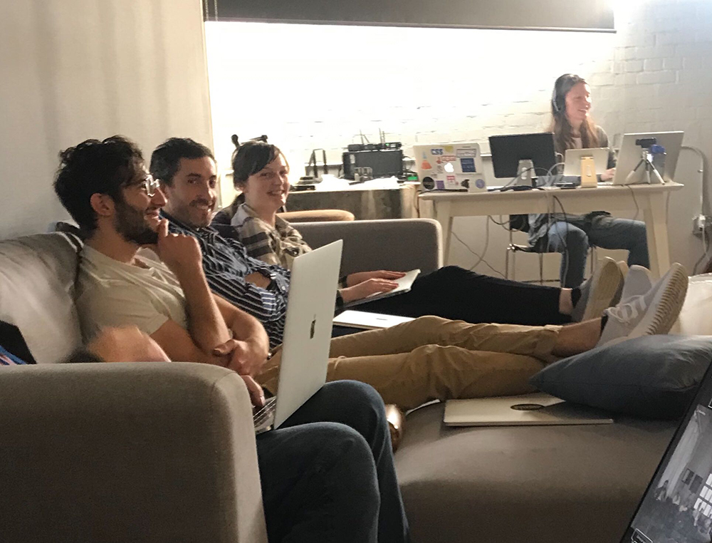 Photo of a few of the team members at an Exaptive company meeting.